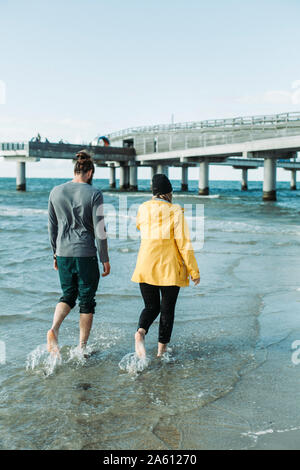 Couple walking at the beach in Heiligenhafen - Stock Photo