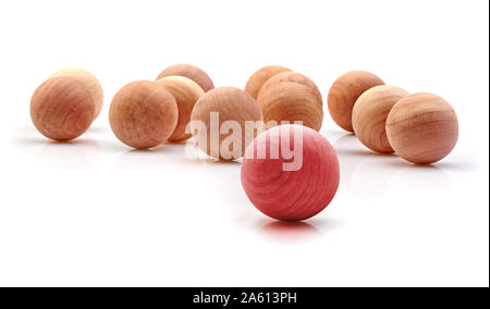 One Red Cedar Ball Stand Out From The Crowd on white - Stock Photo