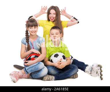 playful little boy and girls sitting on the floor with ball, skate and rollers isolated on white background - Stock Photo