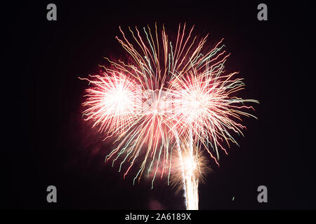 Fireworks photographed in the night sky with a long exposure and black background high quality image good for pc backgrounds and fine art prints. - Stock Photo