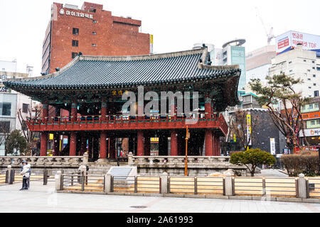Posin-gak (Bosin-gak) in a snowy day in winter, a large bell pavilion on Jongno in Seoul, South Korea, originally constructed in 1396 but destroyed ma - Stock Photo
