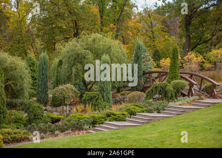 small bridge and green plants, landscape park - Stock Photo