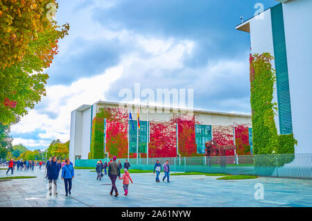 BERLIN, GERMANY - OCTOBER 3, 2019: People walk on the large pedestrian area at the Bundeskanzleramt (German Chancellery building) in the heart of Gove - Stock Photo
