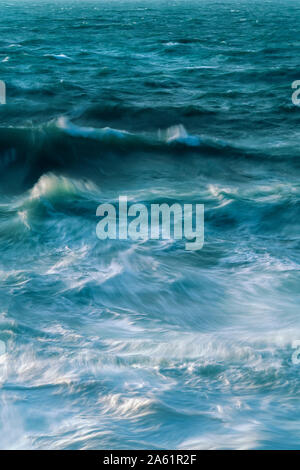Long exposure of waves and the incoming tide - Stock Photo