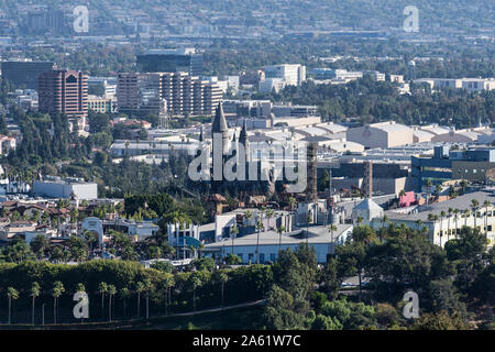 Los Angeles County, California, USA - October 20, 2019:  Morning view of Universal City Hollywood attractions and Warner Bros sound stages. - Stock Photo
