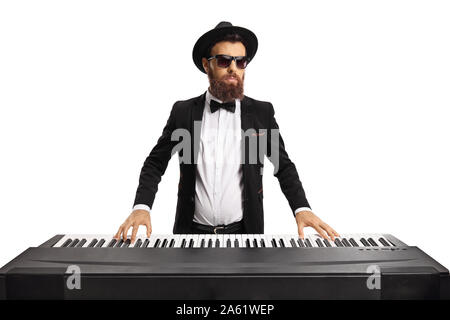 Elegant man wearing a hat and sunglasses playing on an electric piano isolated on white background - Stock Photo