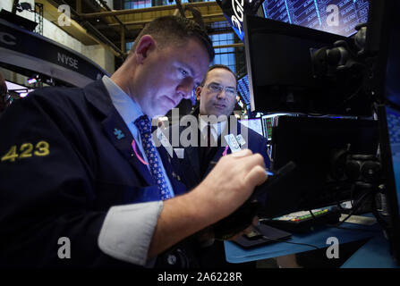 New York, United States. 23rd Oct, 2019. Traders work on the the floor of the New York Stock Exchange at the Opening Bell on Wall Street in New York City on Wednesday, October 23, 2019. Photo by John Angelillo/UPI Credit: UPI/Alamy Live News - Stock Photo