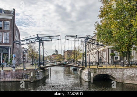 Schiedam, The Netherlands, October 23, 2019: classic steel pedestrian bridge across the Short Harbour where it meets the Long Harbour, on  a beautiful - Stock Photo