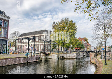 Schiedam, The Netherlands, October 23, 2019: the former Corn Exchange building, now the public library and the adjacent canals on a beautiful day in a - Stock Photo