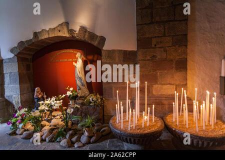Candles and Virgin Mary in Saint-Etienne church, Saint-Étienne-de-Baïgorry, Pyrénées-Atlantiques, France - Stock Photo
