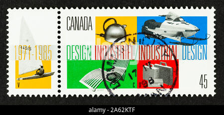 Close up of  postage stamp celebrating Canadian industrial design. Stamp with tab depicts various Made in Canada objects. - Stock Photo