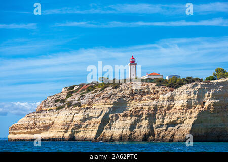 Farol de Alfanzina/Alfanzina lighthouse on the clifftop at  Carvoeiro portugese algarve portugal - Stock Photo