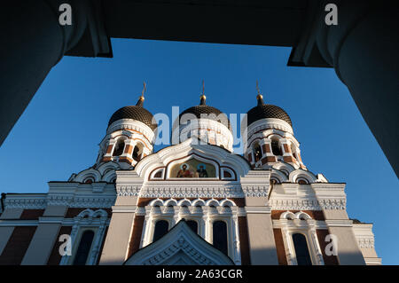 View through colonnade of Alexander Nevsky cathedral in Tallinn old town against blue sky - Stock Photo