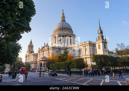 View from St Paul's Churchyard of the London landmark, historic St Paul's Cathedral and dome designed by Sir Christopher Wren on a sunny autumn day