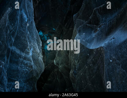 Ancient ice layers from the blue glacier cave in Iceland - Stock Photo