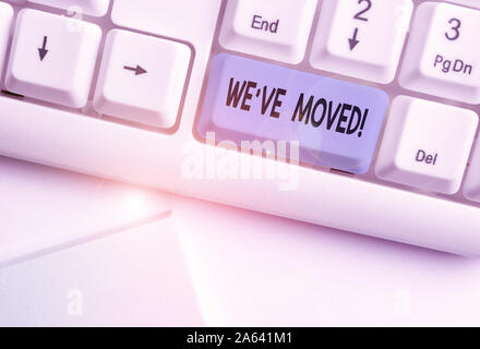 Writing note showing We Ve Moved. Business concept for To go from one residence or location to another Relocate White pc keyboard with note paper abov - Stock Photo