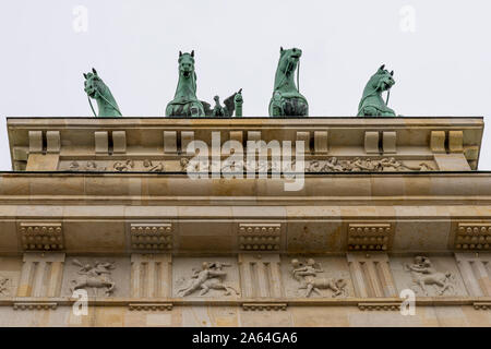 Detail of the Brandenburg Gate and the Quadriga above it in the center of Berlin, Germany, viewed from below - Stock Photo