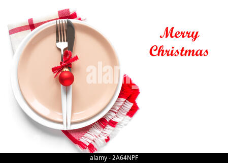 Christmas Table Setting with red ribbon and ornaments on white, flat lay, copy space. Christmas dinner, party design, concept - table setting with fes - Stock Photo