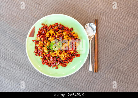 Sichuan Szechuan fried chicken with spicy red hot chillies. Asia China Chinese food cuisine. Chengdu Chongqing culinary. - Stock Photo