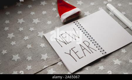 Notebook with pen to write goals of new year on christmas background - Stock Photo