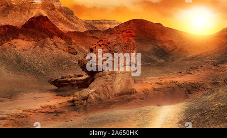Fire sunset in Timna Park. Negev Desert. National Park in Israel. - Stock Photo