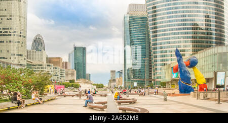 people relaxing on the promenade of la defense - Stock Photo