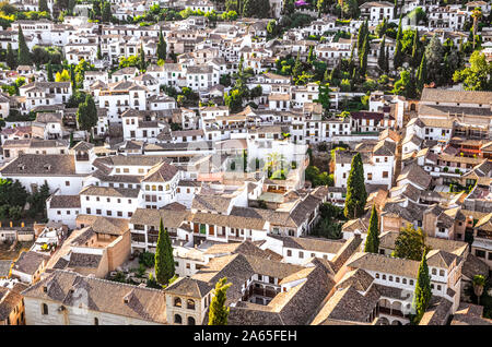 Historical district Albaicin in Granada, Spain photographed from above. Narrow winding streets with traditional buildings dating back to medieval Muslim rule over the city. Moorish architecture. - Stock Photo