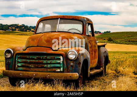 Vintage truck rusted in field - Stock Photo