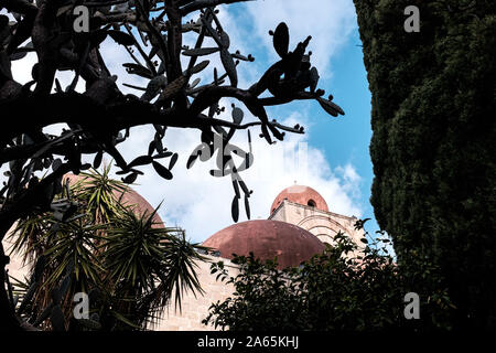 Palermo, Sicily, Italy - 20 December 2018: Cupola of the San Cataldo church seen from below with prickly pear plant and palm trees in the foreground - Stock Photo