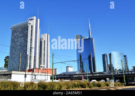 Milan/Italy - October 16, 2019: Panoramic view to Porta Garibaldi railway station hotels and Porta Nuova modern buildings and a bridge in a sunny day. - Stock Photo