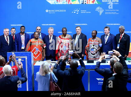 Sochi, Russia. 24th Oct, 2019. SOCHI, RUSSIA - OCTOBER 24, 2019: Prince Hlangusemphi (C), Head of the Defence Ministry of the Kingdom of Eswatini, and Grigory Ivliyev (2nd L middle), Head of the Russian Federal Service for Intellectual Property, sign a cooperation agreement on the sidelines of the 2019 Russia-Africa Economic Forum at the Sirius Park of Science and Art. Dmitry Feoktistov/TASS Host Photo Agency Credit: ITAR-TASS News Agency/Alamy Live News - Stock Photo