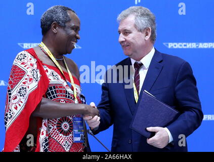 Sochi, Russia. 24th Oct, 2019. SOCHI, RUSSIA - OCTOBER 24, 2019: Prince Hlangusemphi (L), Head of the Defence Ministry of the Kingdom of Eswatini, and Grigory Ivliyev, Head of the Russian Federal Service for Intellectual Property, sign a cooperation agreement on the sidelines of the 2019 Russia-Africa Economic Forum at the Sirius Park of Science and Art. Dmitry Feoktistov/TASS Host Photo Agency Credit: ITAR-TASS News Agency/Alamy Live News - Stock Photo