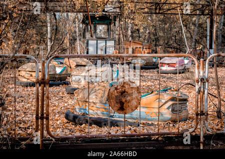 abandoned old amusement park in Chernobyl Ukraine in autumn - Stock Photo