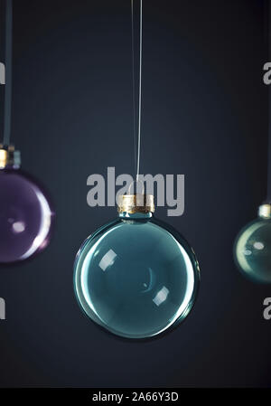 Exciting Glass christmas balls hanging in front of dark grey background. winter holiday greeting card. Design Template with Copy Space. - Stock Photo