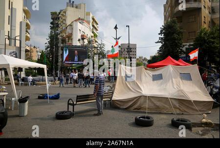 Beirut, Lebanon. 24th Oct, 2019. The televised speech of Lebanese President Michel Aoun, is displayed on a big screen. Credit: Marwan Naamani/dpa/Alamy Live News - Stock Photo
