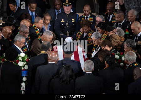 Washington, United States. 24th Oct, 2019. Members of the Congressional Black Caucus gather around the casket at a memorial service for late Maryland Representative Elijah Cummings in National Statuary Hall at the U.S. Capitol in Washington, DC on Thursday, October 24, 2019. Cummings died at the age of 68 on October 17 due to complications concerning long-standing health challenges. Pool Photo by Erin Schaff/UPI Credit: UPI/Alamy Live News - Stock Photo