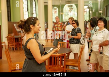 A tour guide shows Gilman Hall to a campus tour group on the Homewood Campus of the Johns Hopkins University in Baltimore, Maryland, August 12, 2010. From the Homewood Photography collection. () - Stock Photo