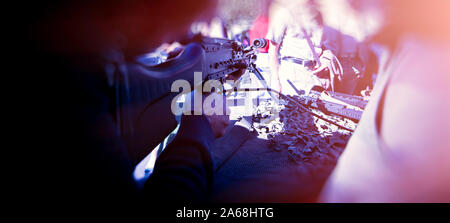 POV personal perspective of man holding a semi-automatic rifle point it to silhouettes of people - blue color cast - Stock Photo