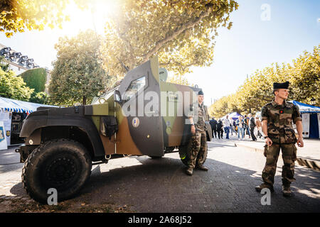 Strasbourg, France - Sep 21, 2019: Soldiers near Petit vehicule protege Armoured Infantry Fighting Vehicle Manufactured by Panhard - Stock Photo