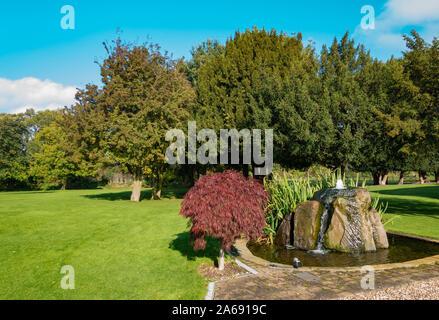 beautiful water fountain in rock - Stock Photo