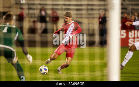 Indiana University's Joshua Penn (11) takes a shot against Evansville's Frederik Reimer (1) during an NCCA soccer game Tuesday, Oct., 22, 2019 at Armstrong Stadium, in Bloomington, Ind. (Photo by Jeremy Hogan/The Bloomingtonian) - Stock Photo