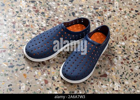 Pair of Blue Shoes Isolated on Mosaic Floor Background