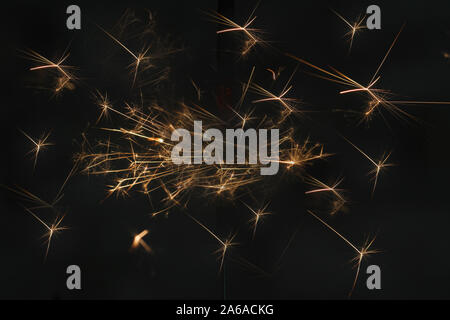 sparkler alight in the dark to celebrate November 5th or Bonfire Night or Guy Fawkes also used to celebrate 4th July and other holidays and festivals - Stock Photo