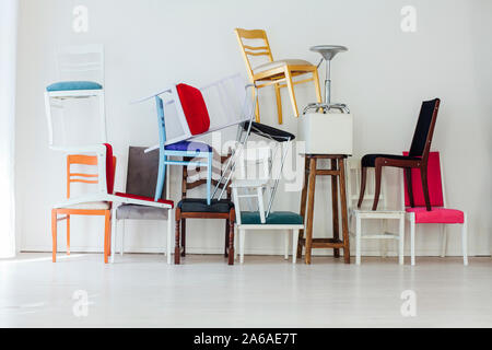 lots of chairs at the wall in the interior of the white office - Stock Photo