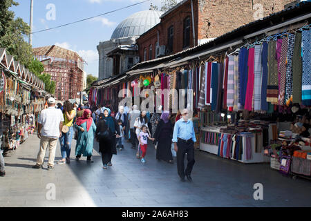 Istanbul, Turkey - September-14,2019: Eyup Sultan traditional market. Clothing and Islamic culture items are sold. - Stock Photo