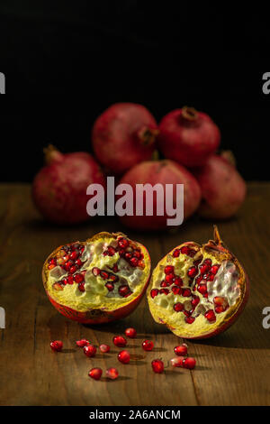 still life of ripe red pomegranates on a table Stock Photo