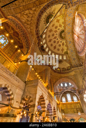 ISTANBUL TURKEY SULTAN AHMED OR BLUE MOSQUE INTERIOR MAIN HALL DECORATED ARCHES AND DOME - Stock Photo