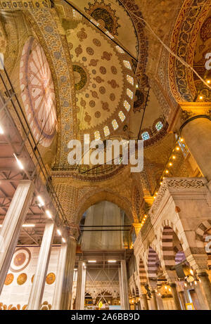 ISTANBUL TURKEY SULTAN AHMED OR BLUE MOSQUE INTERIOR MAIN HALL THE DECORATED ARCHES AND DOME - Stock Photo