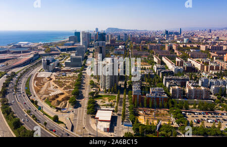 Panoramic aerial view of modern area of Diagonal Mar i el Front Maritim del Poblenou in coastal zone of Barcelona, Spain - Stock Photo