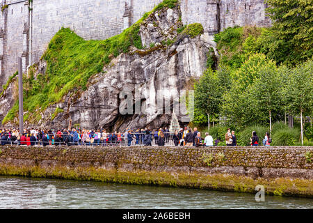 LOURDES - JUNE 15, 2019: view of the cave and the pilgrims of the Sanctuary of Lourdes, France - Stock Photo